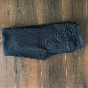 Black AEO skinny jeans with distressed knees